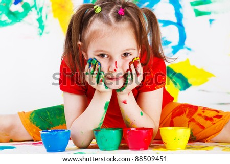 Portrait of a girl with face and hands painted - stock photo