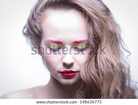 Portrait of a girl with frosty makeup and red lips