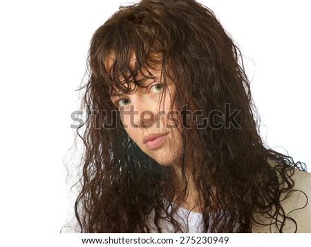 portrait of a girl with green eyes, wet hair and without makeup - stock photo