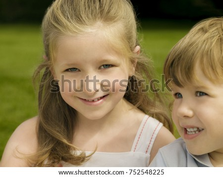 Portrait of a girl with her brother