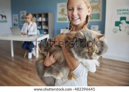 Portrait of a girl with her cat