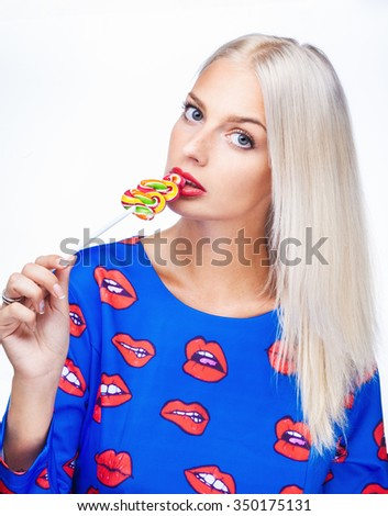 portrait of a girl with lollipop on white - stock photo