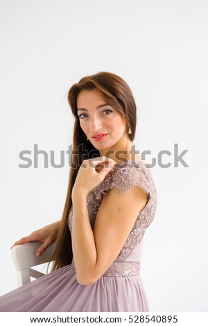 portrait of a girl with long brown hair.with jewelry.
