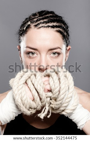 portrait of a girl with rope on her hands - stock photo