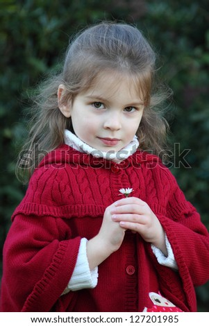 Portrait of a girl with the first flower - stock photo