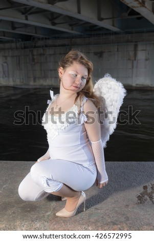 portrait of a girl with white wings - stock photo