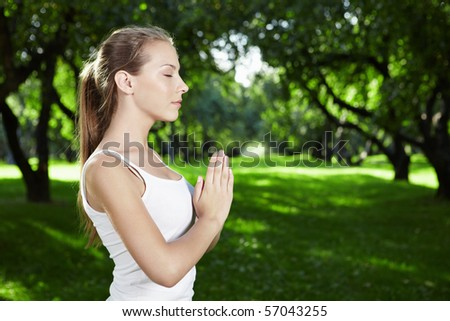 Portrait of a girl yoga in the park - stock photo