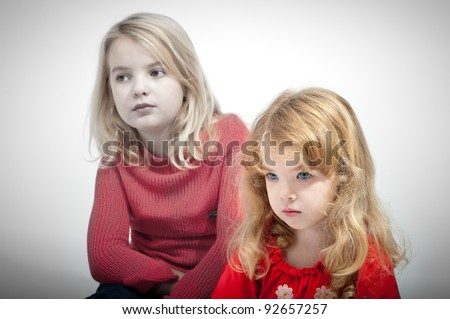 Portrait of a girls with blond hair - stock photo