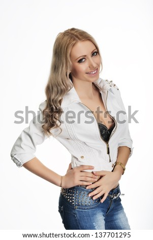 Portrait of a glamorous blonde girl on a white background