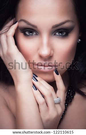 Portrait of a glamorous brunette girl with evening make up and long lashes - stock photo