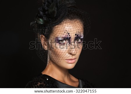 Portrait of a glamorous fashion beautiful girl brunette with sequins on the face