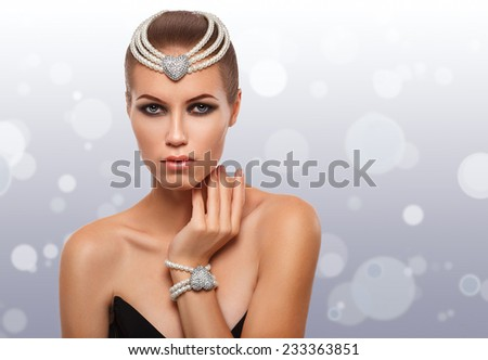 portrait of a glamorous girl in a pearl necklace. beauty. clear skin. luxurious lady - stock photo