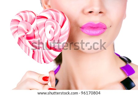 portrait of a glamourous beautiful woman holding lollipop