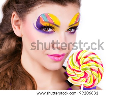 portrait of a glamourous beautiful woman holding lollipop - stock photo