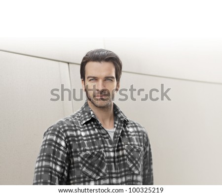 Portrait of a good looking guy against bright modern background with lots of copy space