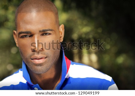 Portrait of a good looking male model outdoors - stock photo