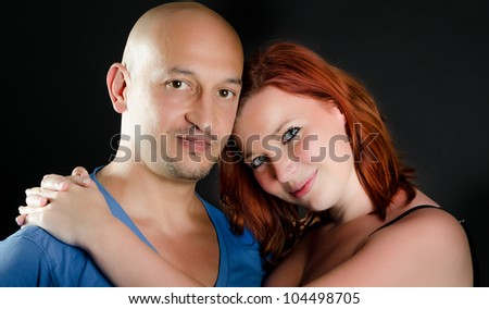 Portrait of a good looking man and a pretty redheaded woman - stock photo