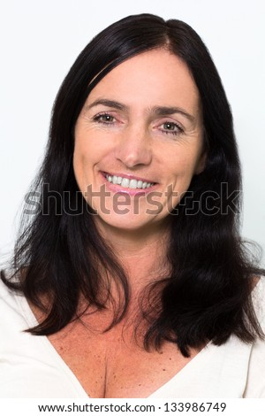 Portrait of a good looking mature Woman - stock photo
