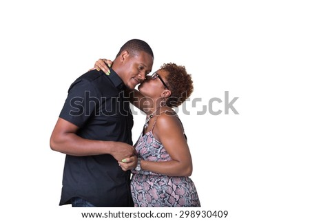 Portrait of a gorgeous African American couple looking kissing isolated on white