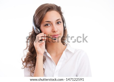 Portrait of a gorgeous brunette woman with headset. - stock photo