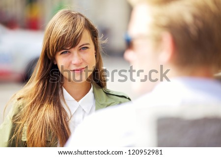 Portrait of a gorgeous woman looking at her boyfriend with love