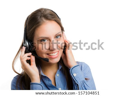 Portrait of a gorgeous woman using an headset - stock photo
