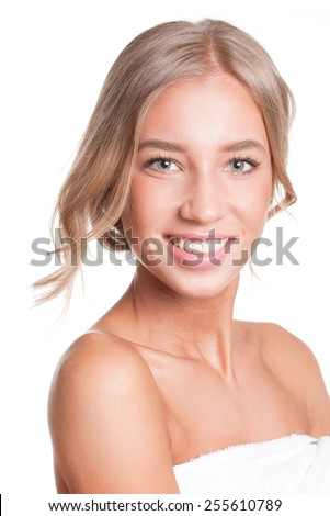 Portrait of a gorgeous young blond woman in bathing towel. - stock photo
