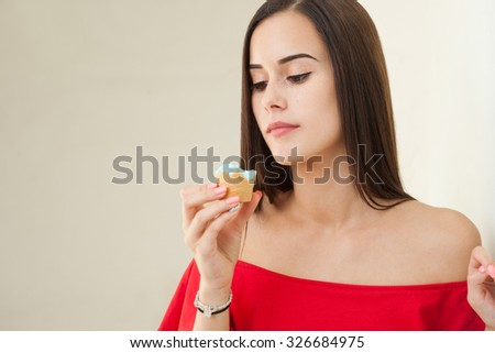 Portrait of a gorgeous young brunette woman having ice cream.