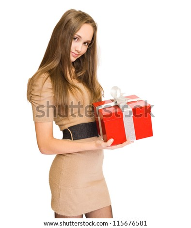 Portrait of a gorgeous young brunette woman holding bright red gift box. - stock photo