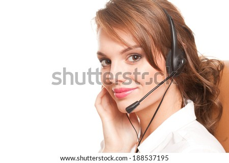 Portrait of a gorgeous young brunette woman wearing headset. - stock photo