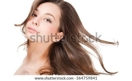Portrait of a gorgeous young brunette woman with healthy hair. - stock photo