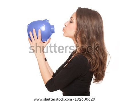 Portrait of a gorgeous young brunette woman with shiny piggy bank.