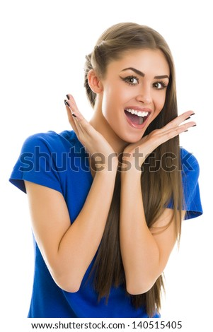 Portrait of a gorgeous young surprised cheerful woman in blue T-shirt over white background.