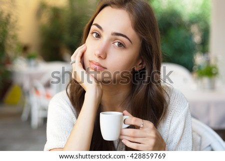 Portrait of a gorgeous young woman having gourmet fun in restaurant.