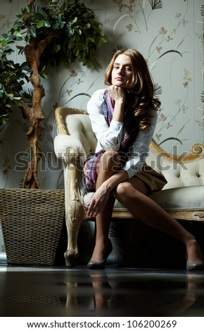 Portrait of a gorgeous young woman in a luxury suite