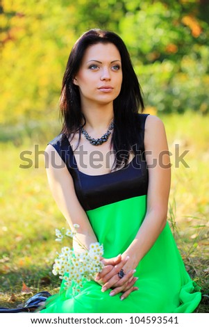 Portrait of a gorgeous young woman outdoors - stock photo