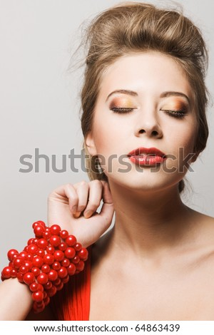 Portrait of a gorgeous young woman with close eyes - stock photo