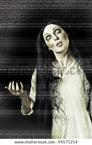 Portrait of a gory bloody and scary zombie woman on black background with television white grain (tv noise) stylization - stock photo