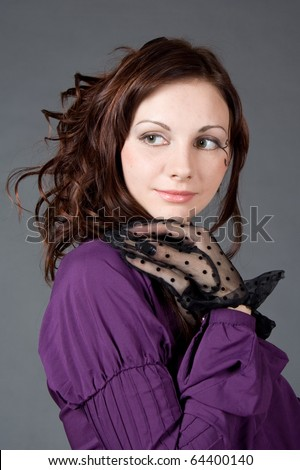 Portrait of a goth girl in a gray backgorund - stock photo