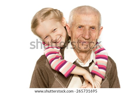 portrait of a granddaughter and grandfather, close-up - stock photo