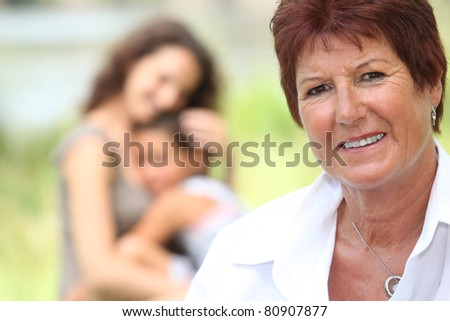 Portrait of a grandmother - stock photo