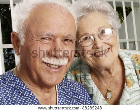 Portrait of a grandparents in a house. - stock photo