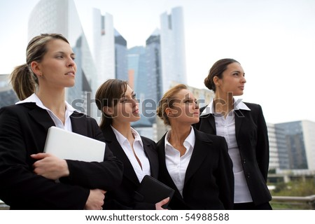 Portrait of a group of businesswomen in suit looking away - stock photo