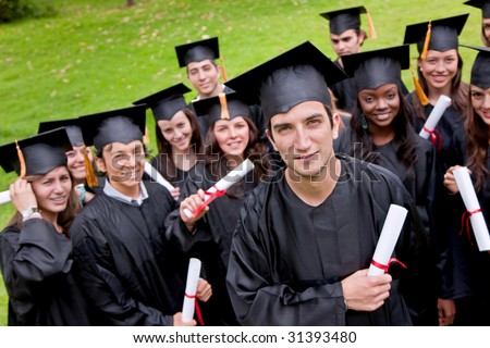 Portrait of a group of grad students outdoors - stock photo