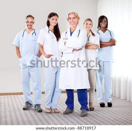 Portrait of a group of mature doctors standing together at the hospital - stock photo