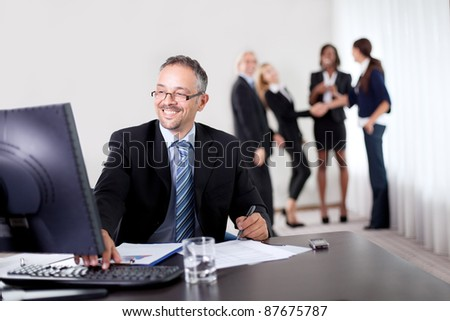 Portrait of a group of mature entrepreneur in meeting at the office with laptop - Showing thumbs up - stock photo