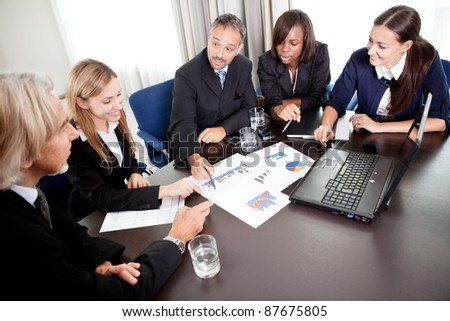 Portrait of a group of mature entrepreneur in meeting at the office with laptop - Showing thumbs up