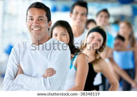 Portrait of a group of people at the gym smiling - stock photo