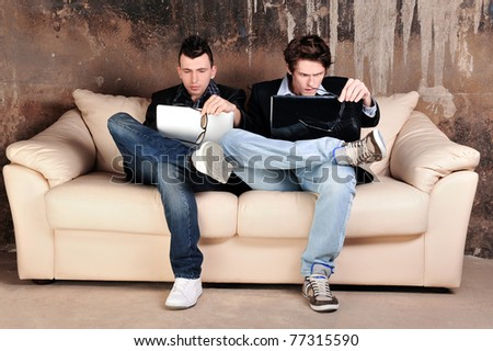 Portrait of a group of students having fun together at their grunge apartment - stock photo