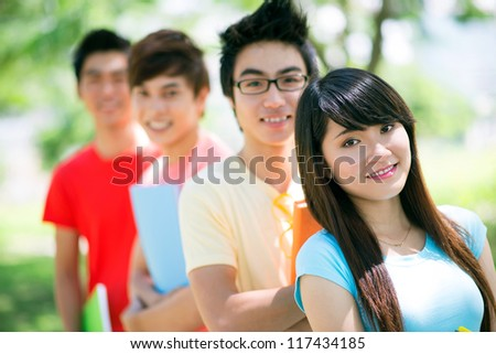 Portrait of a group of students with positive attitude and toothy smiles - stock photo